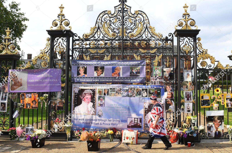 royal wellwisher poses flowers gates Kensington Palace