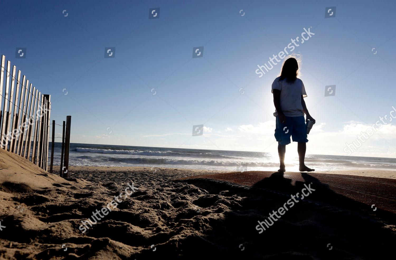 John Oliveto checks out ocean swells Hurricane Editorial