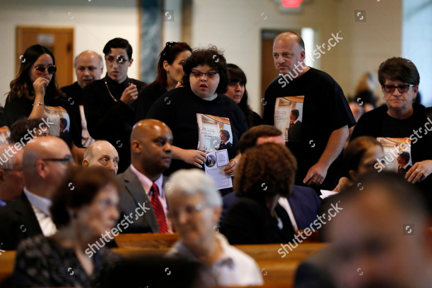 Mourners arrive funeral Evelyn Rodriguez Saint Annes