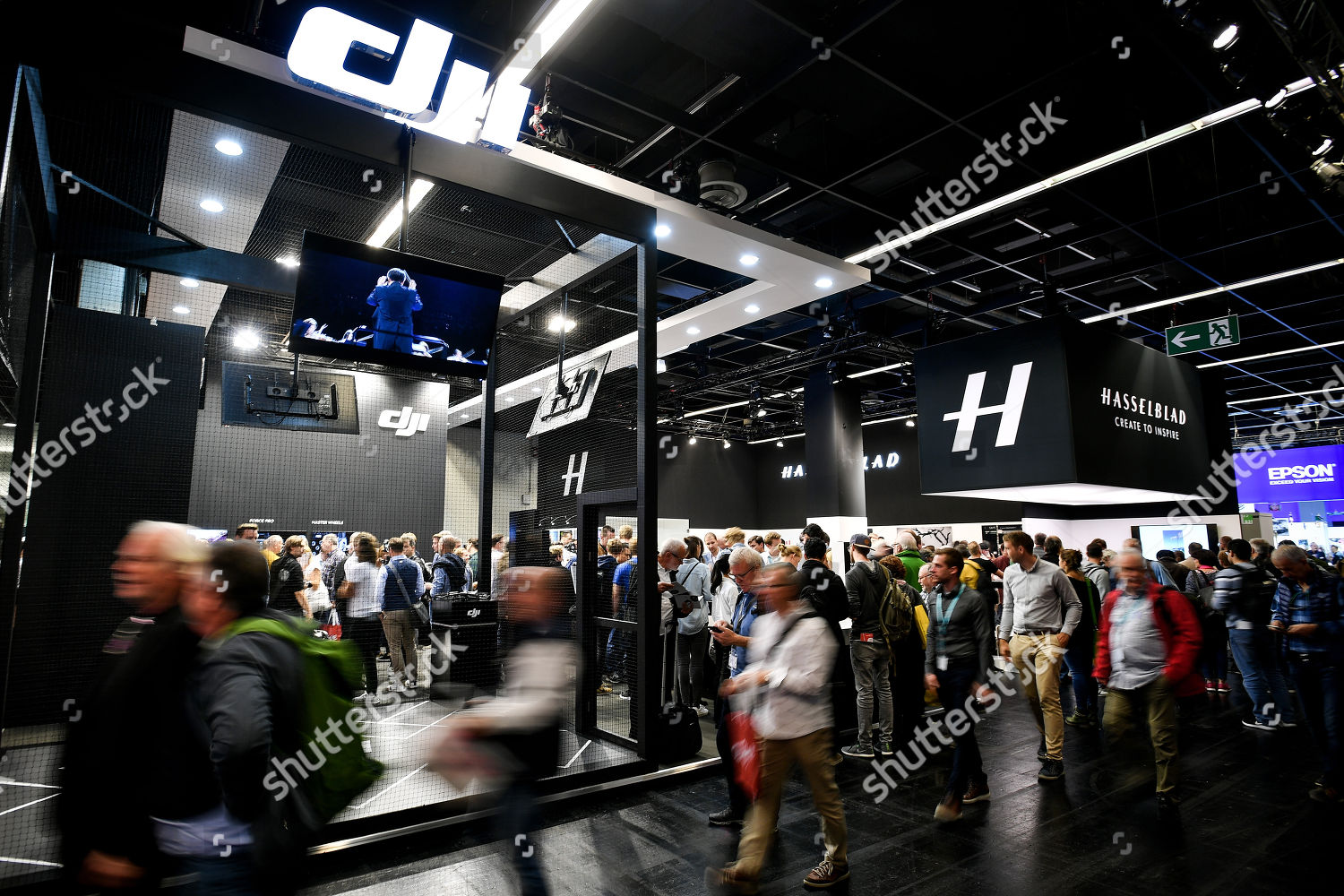 Photography Expo Stands : Visitors gather around dji hasselblad stands during editorial stock