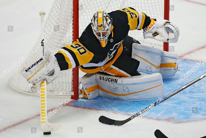 super popular b4bca 10b64 Pittsburgh Penguins goaltender Matt Murray clears puck ...