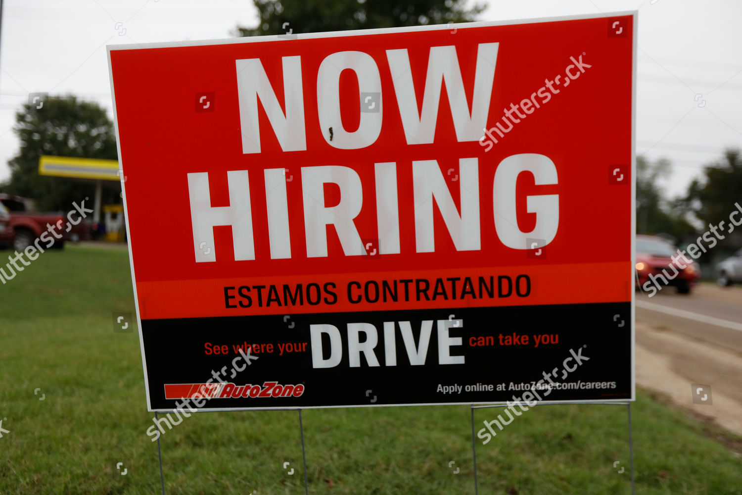 bilingual help wanted sign Auto Zone retailer Editorial