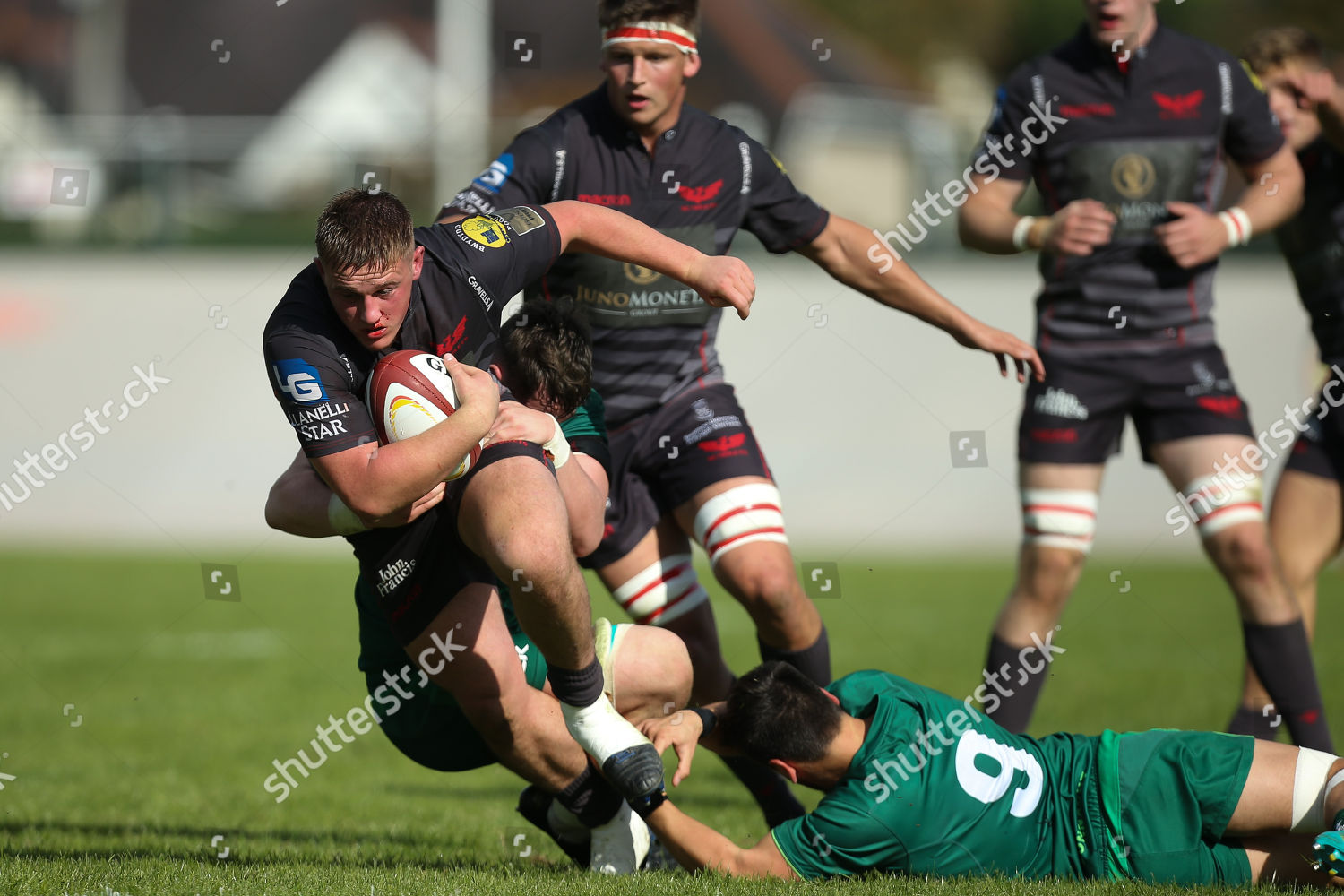 Dafydd Hughes Scarlets tackled he charges towards Editorial