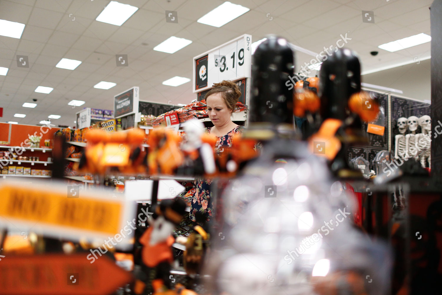 customer looks through halloween section called hyde editorial stock