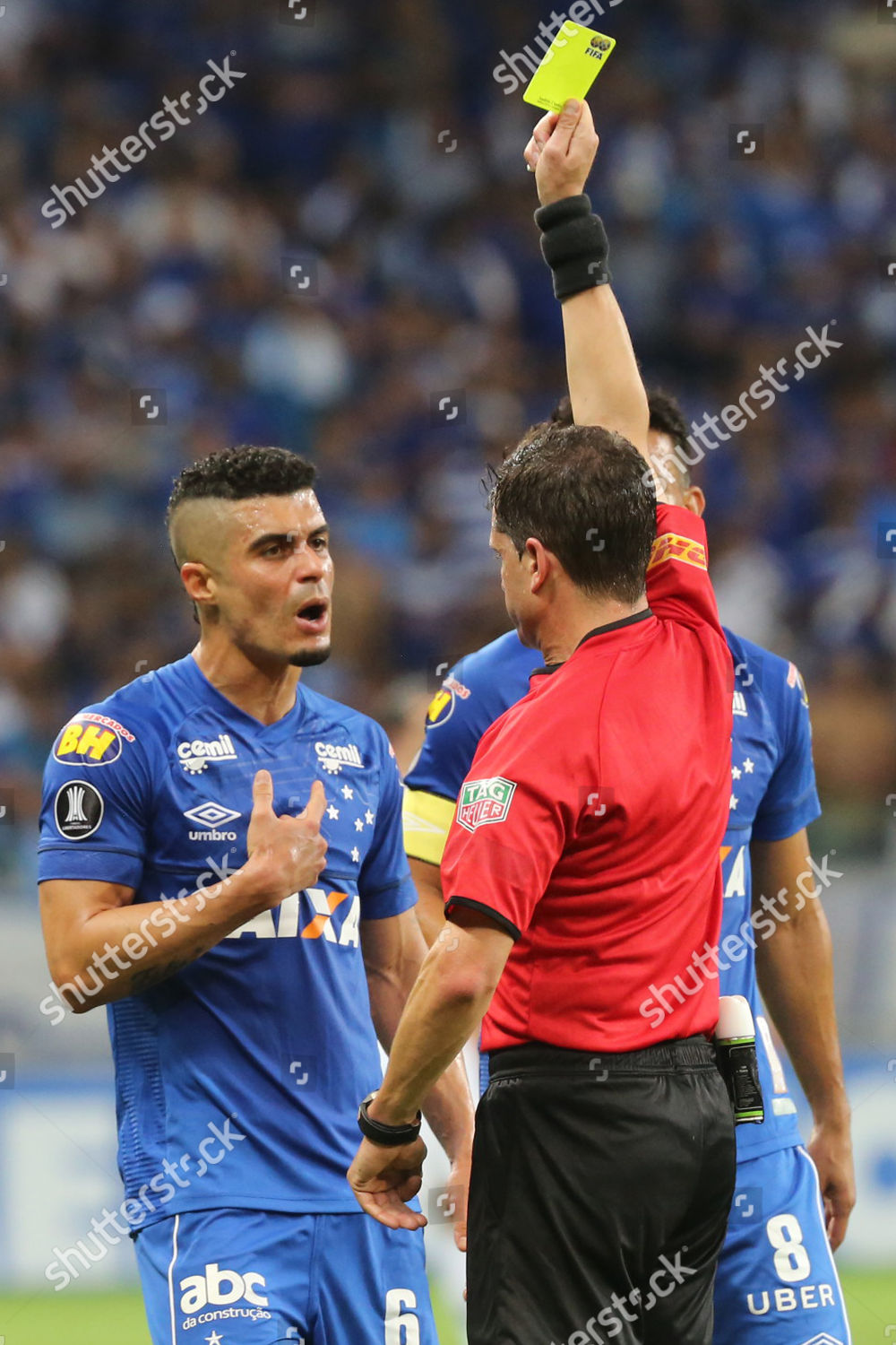 Uruguayan referee Andres Cunha R shows yellow Editorial Stock Photo