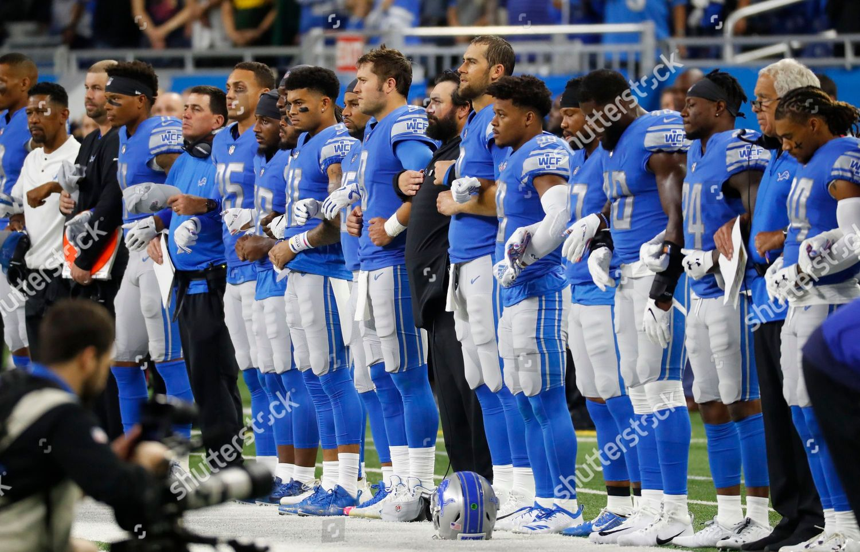 promo code 6a43a 1d074 Detroit Lions coaches players stand arminarm during ...