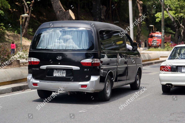 hearse that transports body Councilman Fernando Alban