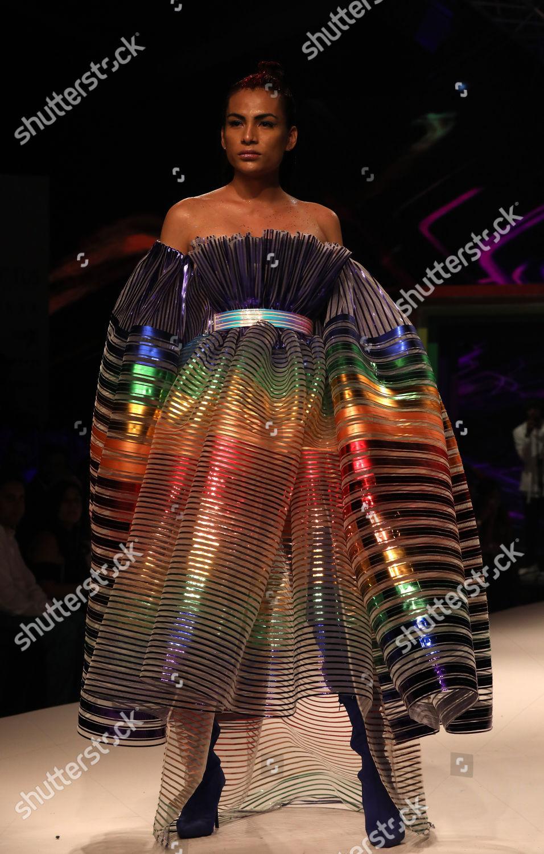 model presents creation during Rainbow theme fashion Editorial Stock