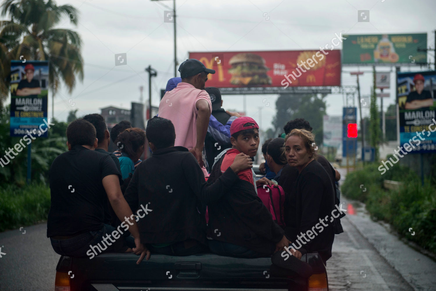 Honduran migrants ride on bed pickup truck Editorial Stock Photo ... 9d2909a810a