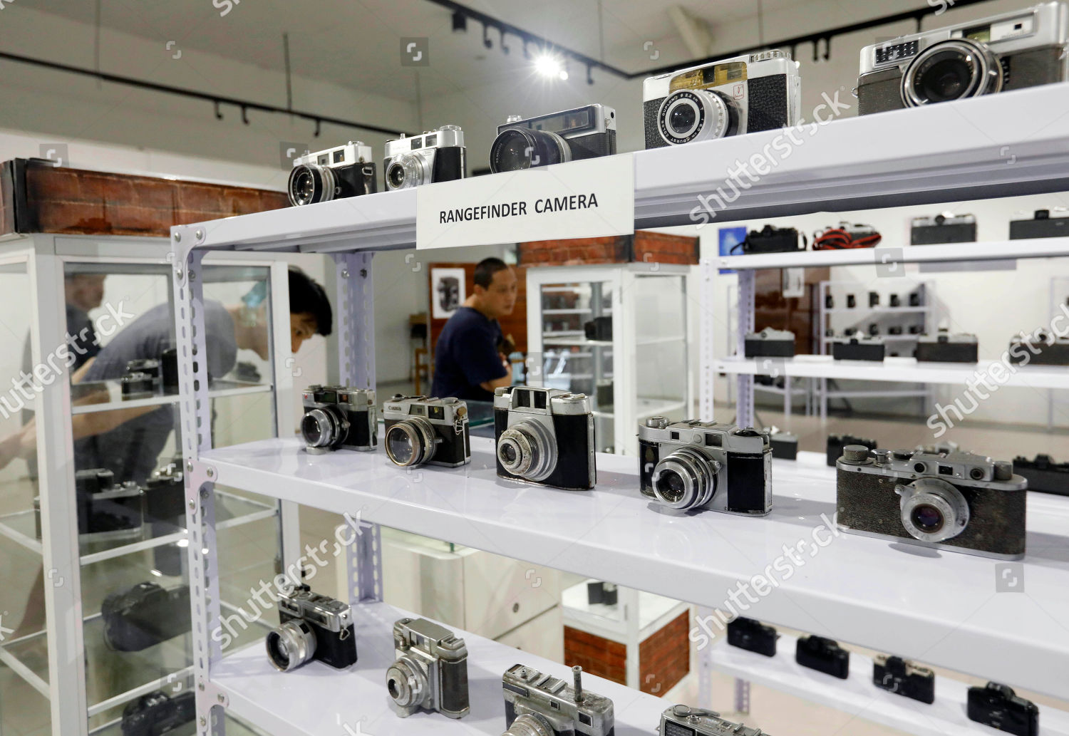Visitors look vintage cameras on display Vintage Editorial