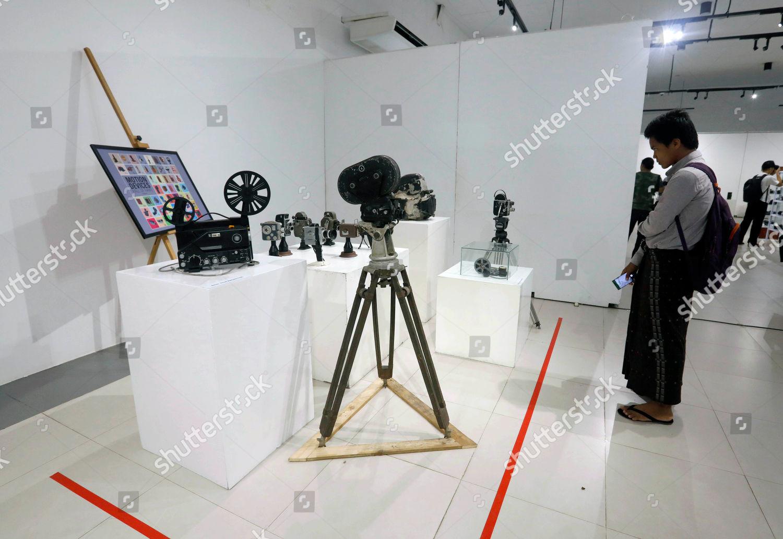 visitor looks vintage cameras on display Vintage Editorial Stock