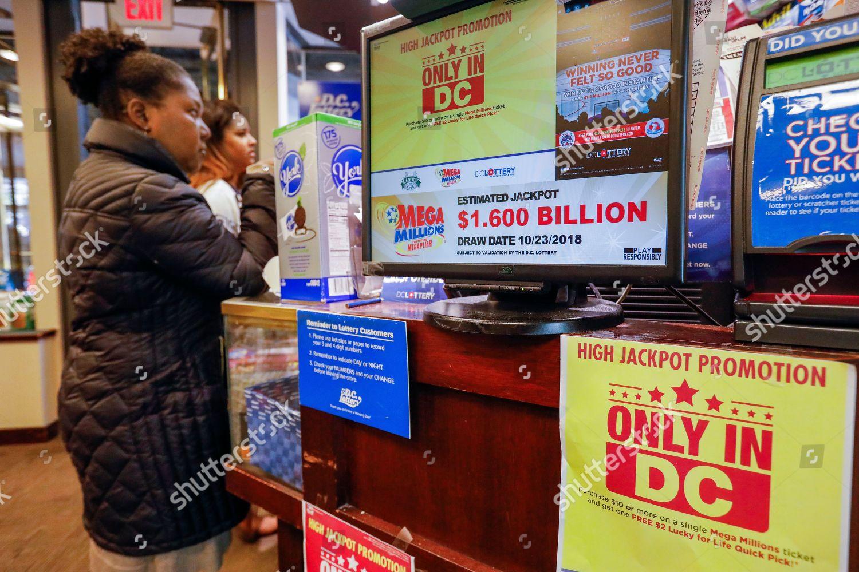 Customers purchase Mega Millions lottery tickets retailer