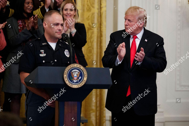 President Donald Trump applauds Nebraska State Trooper