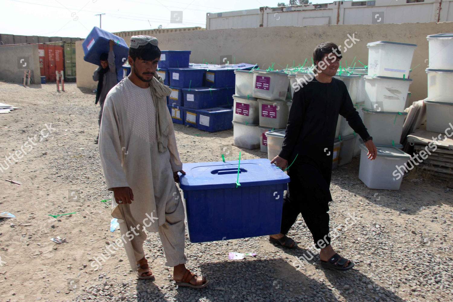 Workers Afghan Independent Election Commission IEC shift
