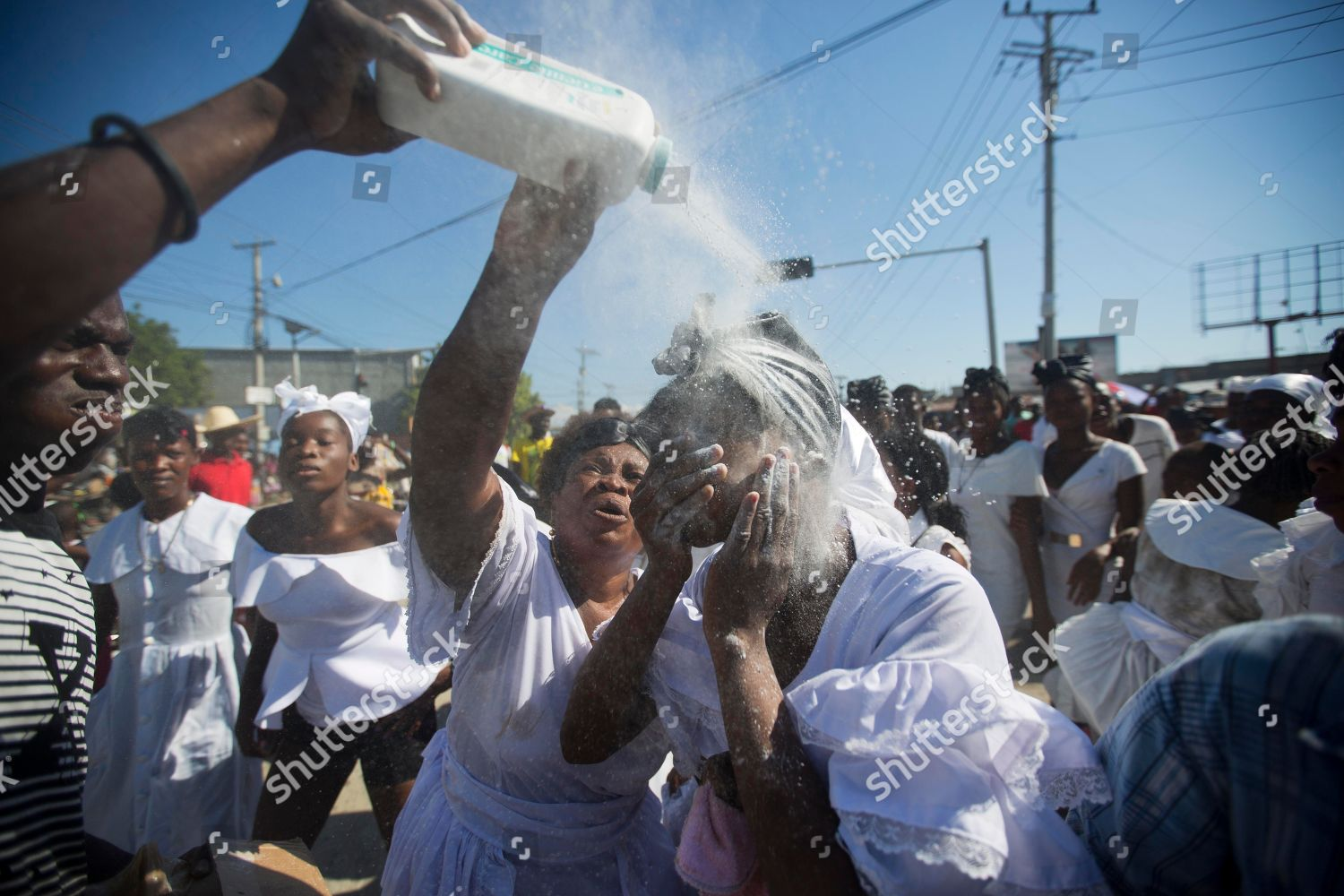 voodoo priest pours white powder on face Editorial Stock Photo