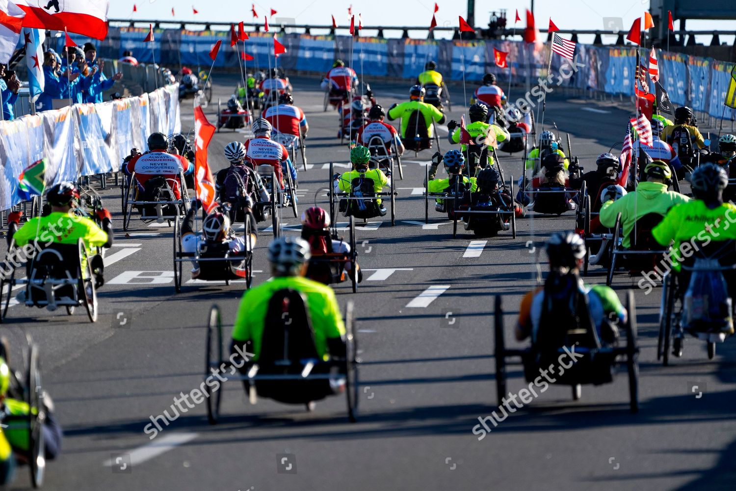 Competitors handcycle division leave starting line during
