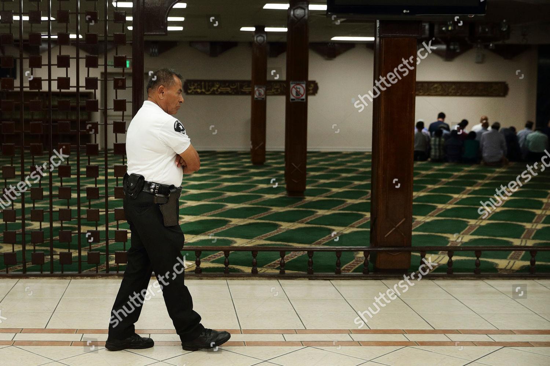 Armed Security Guard Mario Diaz Walks Across Editorial Stock Photo