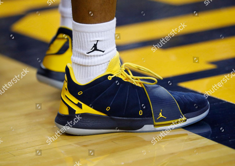 Michigan guard Jordan Pooles Nikes