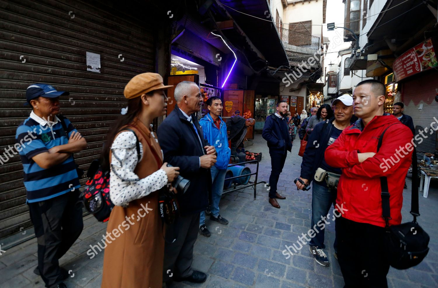 Tour Guide Speaks Some 13 Chinese Tourists Stock Photo 9970183g