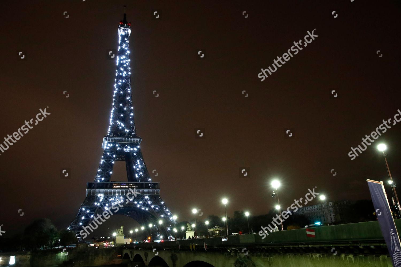 eiffel tower glows twinkling lights 1am final editorial stock photo