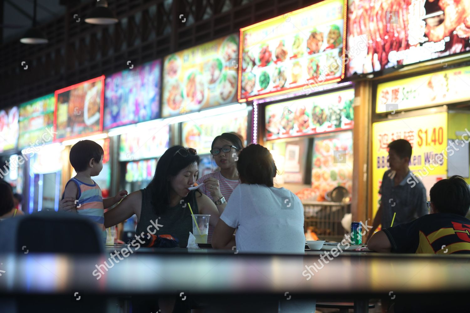 3258 Customers eat local foods purchased hawker Editorial