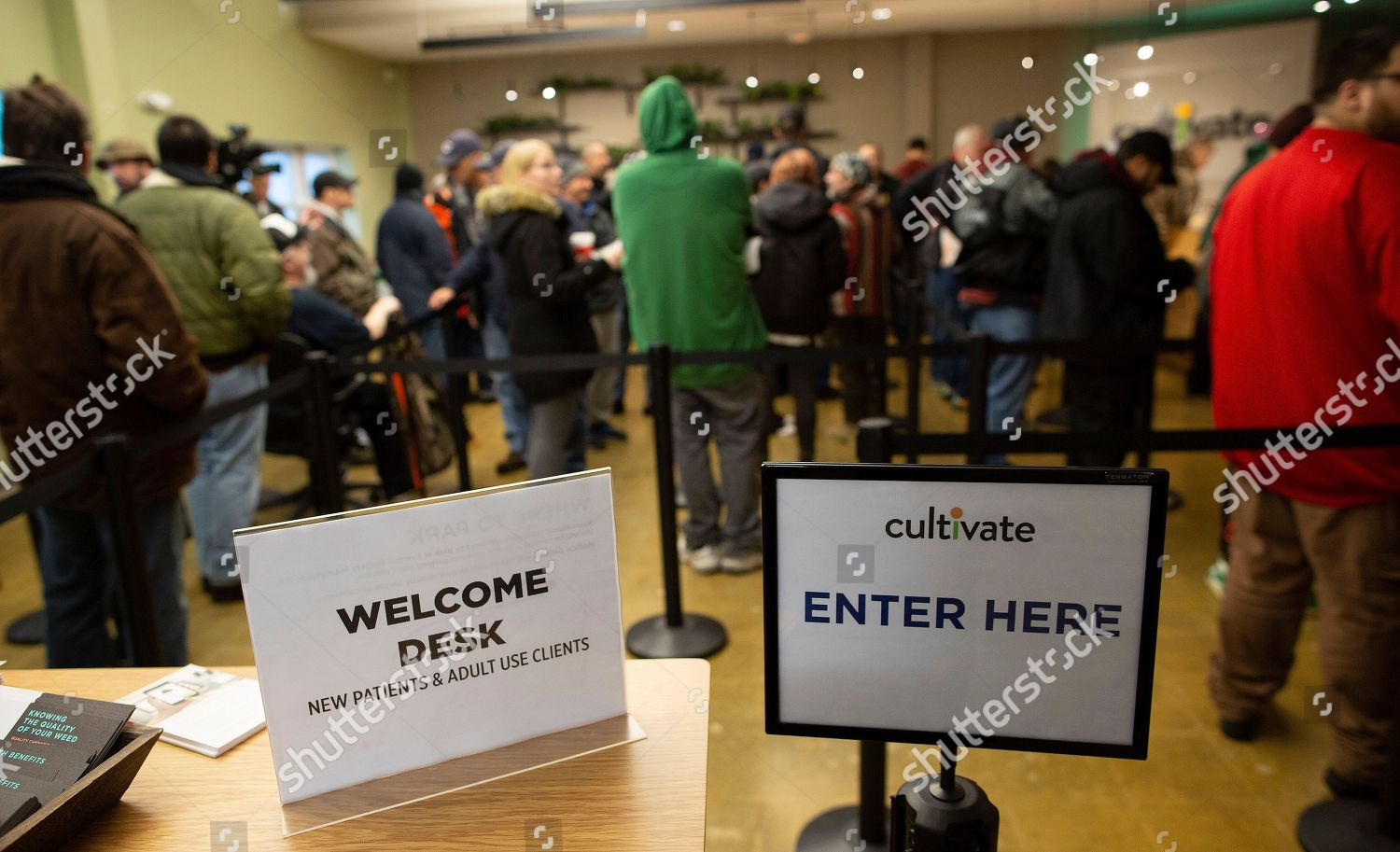 Customers queue inside Cultivate dispensary purchase