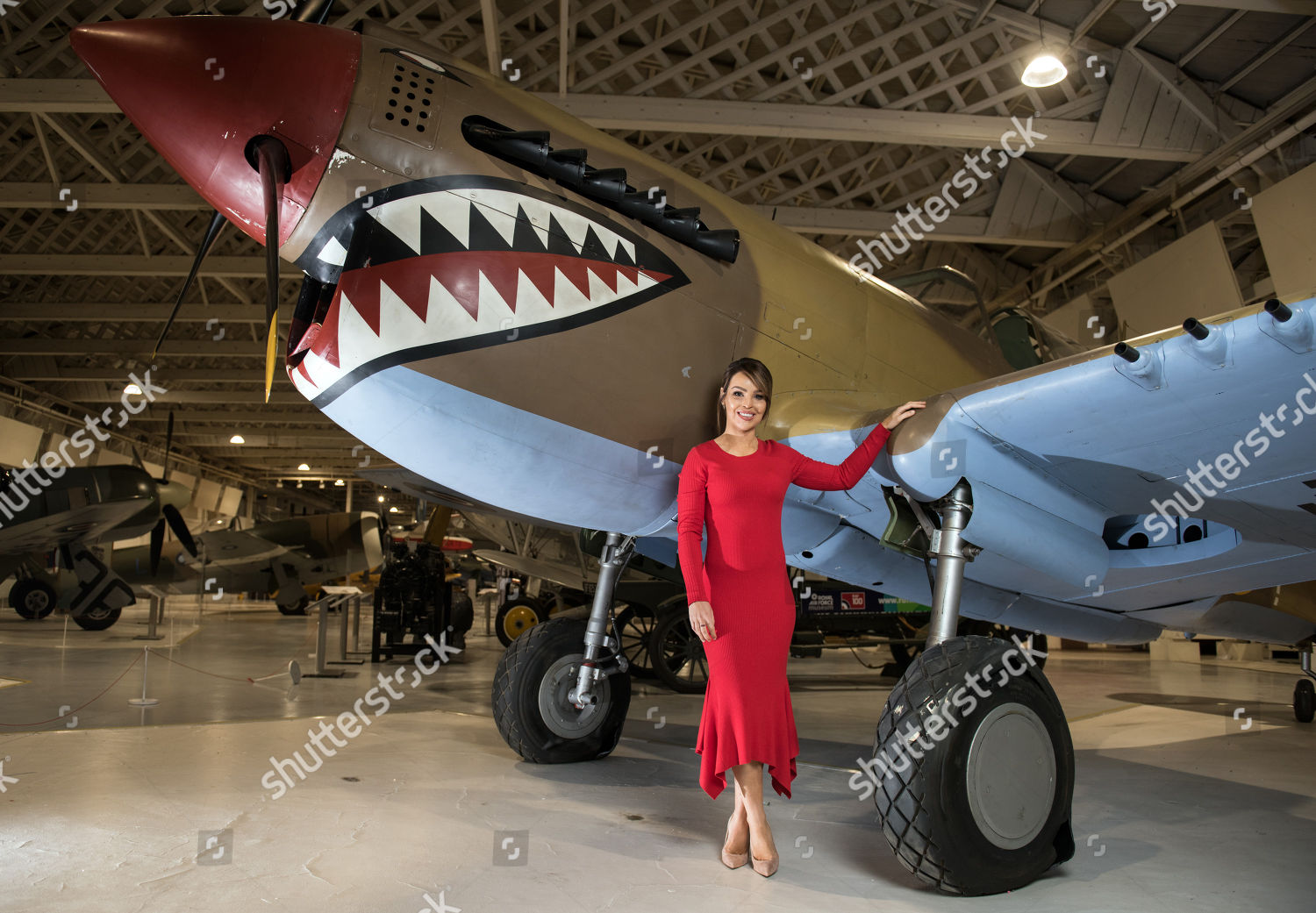Katie Piper poses photograph front Curtiss Kittyhawk