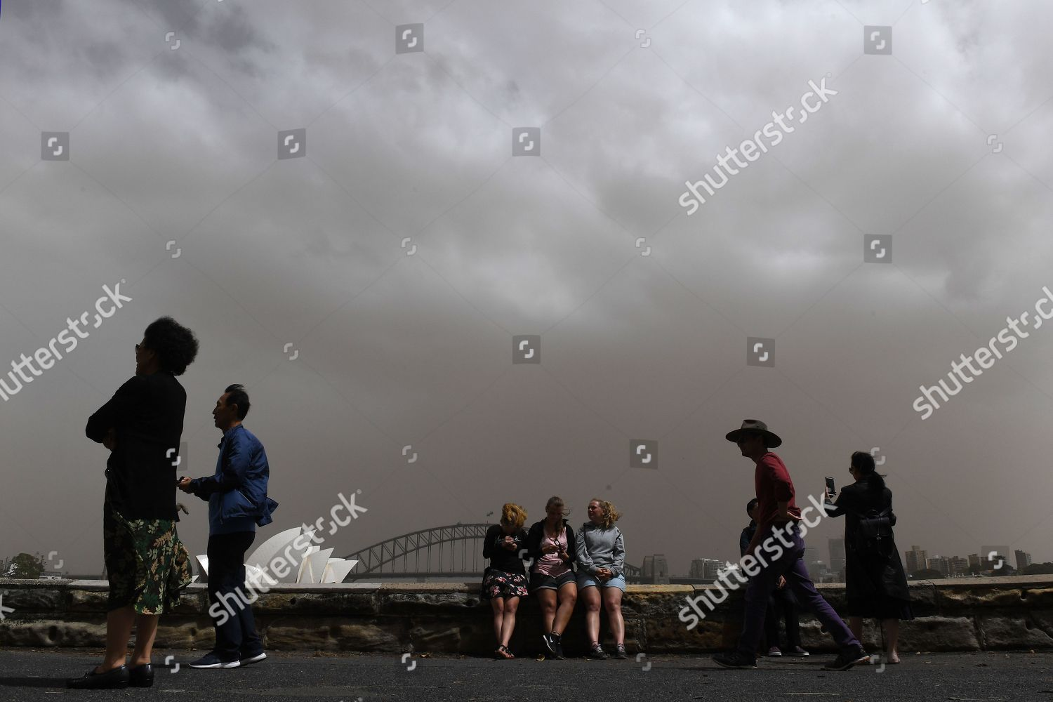Tourists take photographs against backdrop Sydney Harbour Editorial