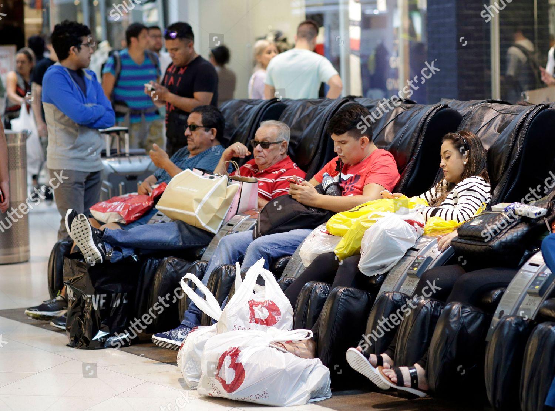 People take break shopping on Black Friday Editorial Stock
