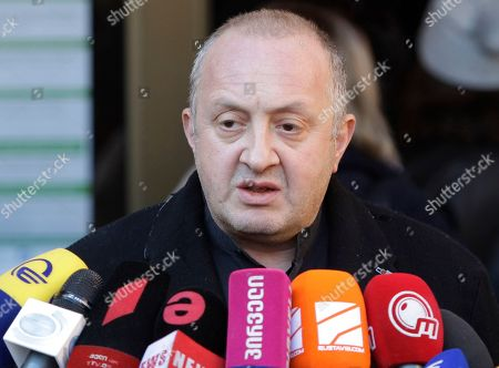 Georgian President Giorgi Margvelashvili speaks to the media outside a polling station in Tbilisi, Georgia, . Two of Georgia's former foreign ministers are facing off against each other Wednesday in a tight runoff that will mark the last time Georgians elect their head of state by popular vote