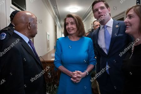 Nancy Pelosi, John Lewis, Eric Swalwell, Kathy Castor. House Democratic Leader Nancy Pelosi of California, smiles as she turns to Rep. John Lewis, D-Ga., left, joined by Rep. Eric Swalwell, D-Calif., right, and Rep. Kathy Castor, D-Fla., far right, after being selected by the Democratic Caucus to be speaker of the House when her party takes the majority in the new Congress in January, at the Capitol in Washington