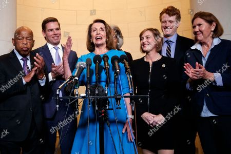 Nancy Pelosi, Kathy Castor, Eric Swalwell, Joyce Beatty, Ann Kirkpatrick, John Lewis, Joe Kennedy. House Minority Leader Nancy Pelosi, D-Calif., joined by from left, Rep. John Lewis, D-Ga., Rep. Eric Swalwell, D-Calif., Rep. Joyce Beatty, D-Ohio., Rep. Kathy Castor, D-Fla., Rep. Joe Kennedy, D-Mass., and Rep. Ann Kirkpatrick, D-Ariz., speaks to media at Longworth House Office Building on Capitol Hill in Washington, to announce her nomination by House Democrats to lead them in the new Congress. She still faces a showdown vote for House speaker when lawmakers convene in January