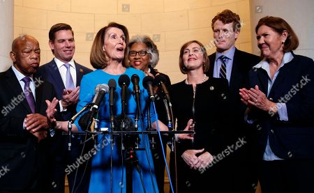 Nancy Pelosi, Kathy Castor, Eric Swalwell, Joyce Beatty, Ann Kirkpatrick, John Lewis, Joe Kennedy. House Minority Leader Nancy Pelosi, D-Calif., joined by from left, Rep. John Lewis, D-Ga., Rep. Eric Swalwell, D-Calif., Rep. Joyce Beatty, D-Ohio., Rep. Kathy Castor, D-Fla., Rep. Joe Kennedy, D-Mass., and Rep. Ann Kirkpatrick, D-Ariz., speaks to media at Longworth House Office Building on Capitol Hill in Washington, to announce her nomination by House Democrats to lead them in the new Congress
