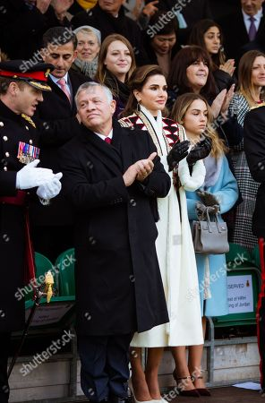 Stock Photo of King Abdullah II and Queen Rania along with their eldest daughter HRH Princess Iman bint Abdullah II at the Royal Military Academy Sandhurst