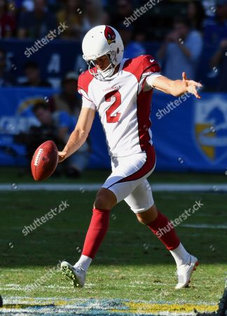 Arizona Cardinals punter Andy Lee (2) punts during the first half of an NFL football game against the Los Angeles Chargers, in Carson, Calif