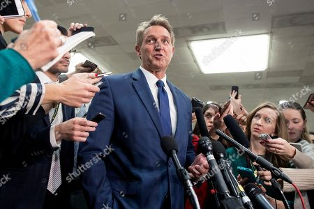Republican Senator from Arizona Jeff Flake (C) speaks to members of the news media following a closed briefing for US senators on Saudi Arabia, on Capitol Hill in Washington, DC, USA, 28 November 2018. Members of the US Senate attended a briefing by US Secretary of State Mike Pompeo and US Secretary of Defense Jim Mattis on developments relating to Saudi Arabia. The Senate is expected to consider a resolution co-sponsored by Independent Senator from Vermont Bernie Sanders and Republican Senator from Utah Mike Lee that would stop US support of Saudi Arabia's involvement in conflict in Yemen following the death of Washington Post contributor Jamal Khashoggi.