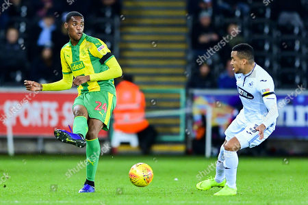 Tosin Adarabioyo of West Bromwich Albion is marked by Martin Olsson of Swansea City