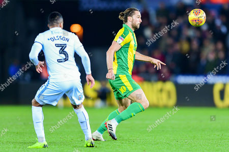 Jay Rodriguez of West Bromwich Albion is marked by Martin Olsson of Swansea City