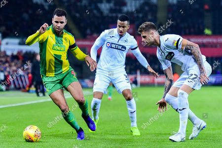 Hal Robson-Kanu of West Bromwich Albion is marked by Martin Olsson of Swansea City and Joe Rodon of Swansea City
