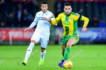 Hal Robson-Kanu of West Bromwich Albion is marked by Martin Olsson of Swansea City- Mandatory by-line: Ryan Hiscott/JMP
