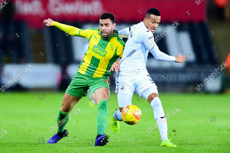 Hal Robson-Kanu of West Bromwich Albion is challenged by Martin Olsson of Swansea City
