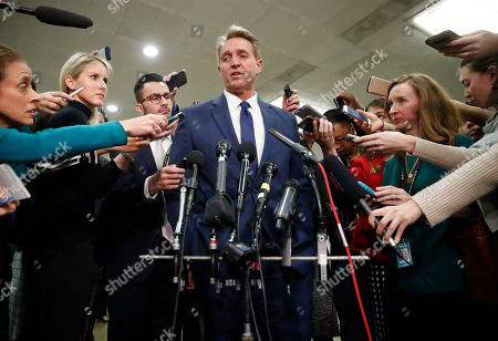 Sen. Jeff Flake, R-Ariz., speaks to members of the media after leaving a closed door meeting about Saudi Arabia with Secretary of State Mike Pompeo, on Capitol Hill in Washington