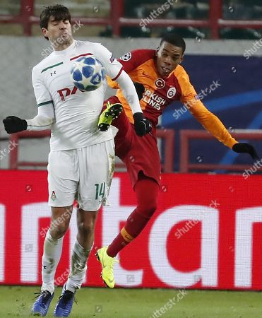 Lokomotiv Moscow's Vedran Corluka (L) in action against Galatasaray's Garry Rodrigues (R) during the UEFA Champions League Group D soccer match between Lokomotiv Moscow and Galatasaray at the Lokomotiv stadium in Moscow, Russia, 28 November 2018.