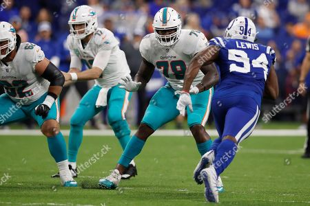 Sam Young, Tyquan Lewis. Miami Dolphins offensive tackle Sam Young (79) sets to block Indianapolis Colts defensive end Tyquan Lewis (94) during an NFL football game in Indianapolis, . The Colts won the game 27-24