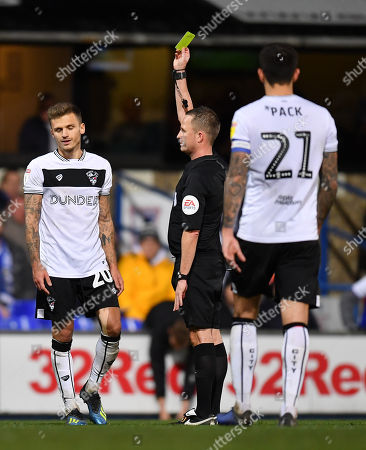 Stock Picture of Referee David Webb shows Jamie Paterson of Bristol City a yellow card