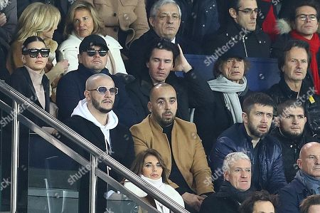 Cami Morrone and Actor Leonardo DiCaprio in the stands alongside Mick Jagger