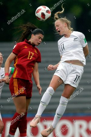Salma Paralluelo of Spain and Kelly Brown of New Zealand compete to head the ball during a 2018 FIFA U-17 Women's World Cup semifinal soccer match in Montevideo, Uruguay