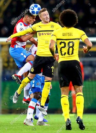 Brugge's Sofyan Amrabat (L) and Dortmund's Marco Reus (R) in action during the UEFA Champions League Group A soccer match between Borussia Dortmund and Club Brugge FC in Dortmund, Germany, 28 November 2018.