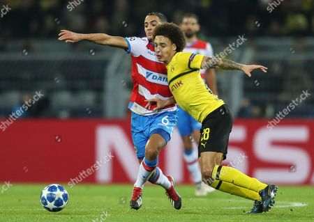 Brugge's Sofyan Amrabat (L) and Dortmund's Axel Witsel (R) in action during the UEFA Champions League Group A soccer match between Borussia Dortmund and Club Brugge FC in Dortmund, Germany, 28 November 2018.