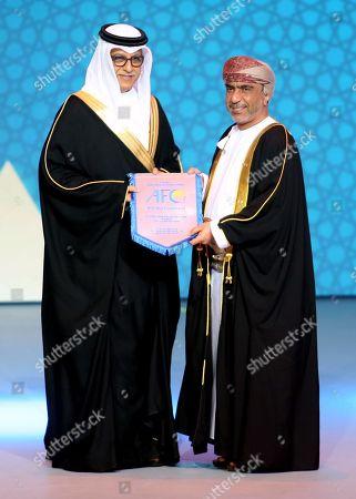Stock Image of AFC President Shaikh Salman bin Ebrahim Al Khalifa (L) honors the President of the Omani Football Federation Sheikh Salem Bin Saeed(R) during the Asian Football Association (AFC) Annual Awards ceremony held in Muscat, Oman, 28 November 2018.
